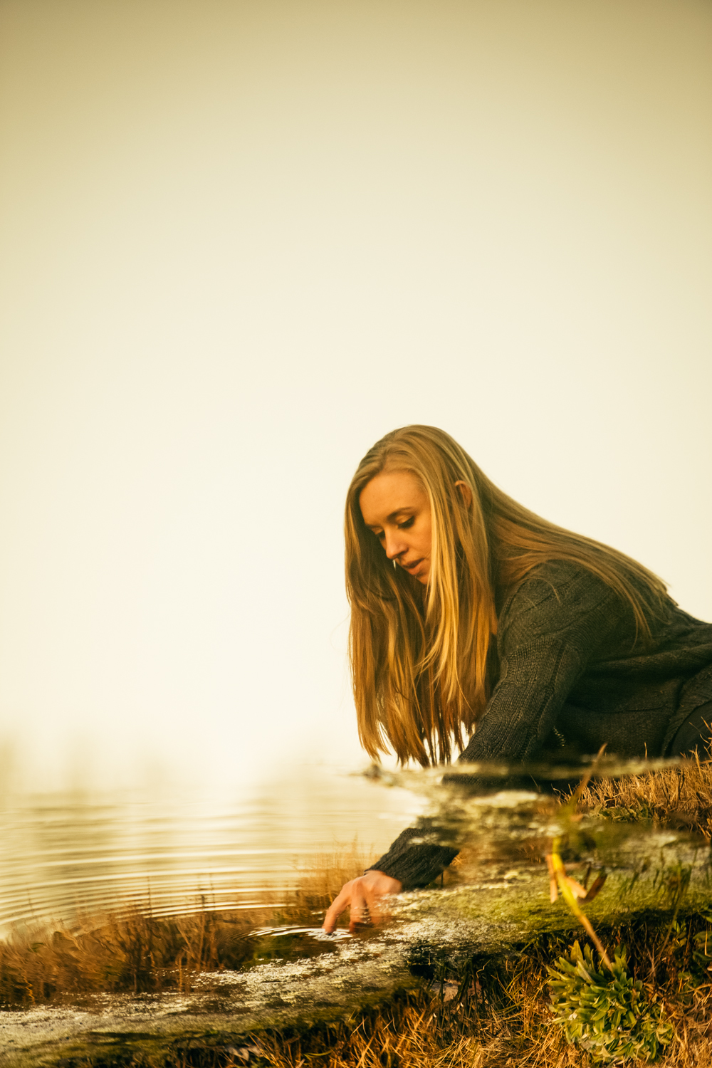 "This image is actually Susanna's reflection in a small pond of water. Workflow was capture > rotate image 180 degrees > Susanna's ""real"" self was photoshopped out > finally, color toning and other effects were added."