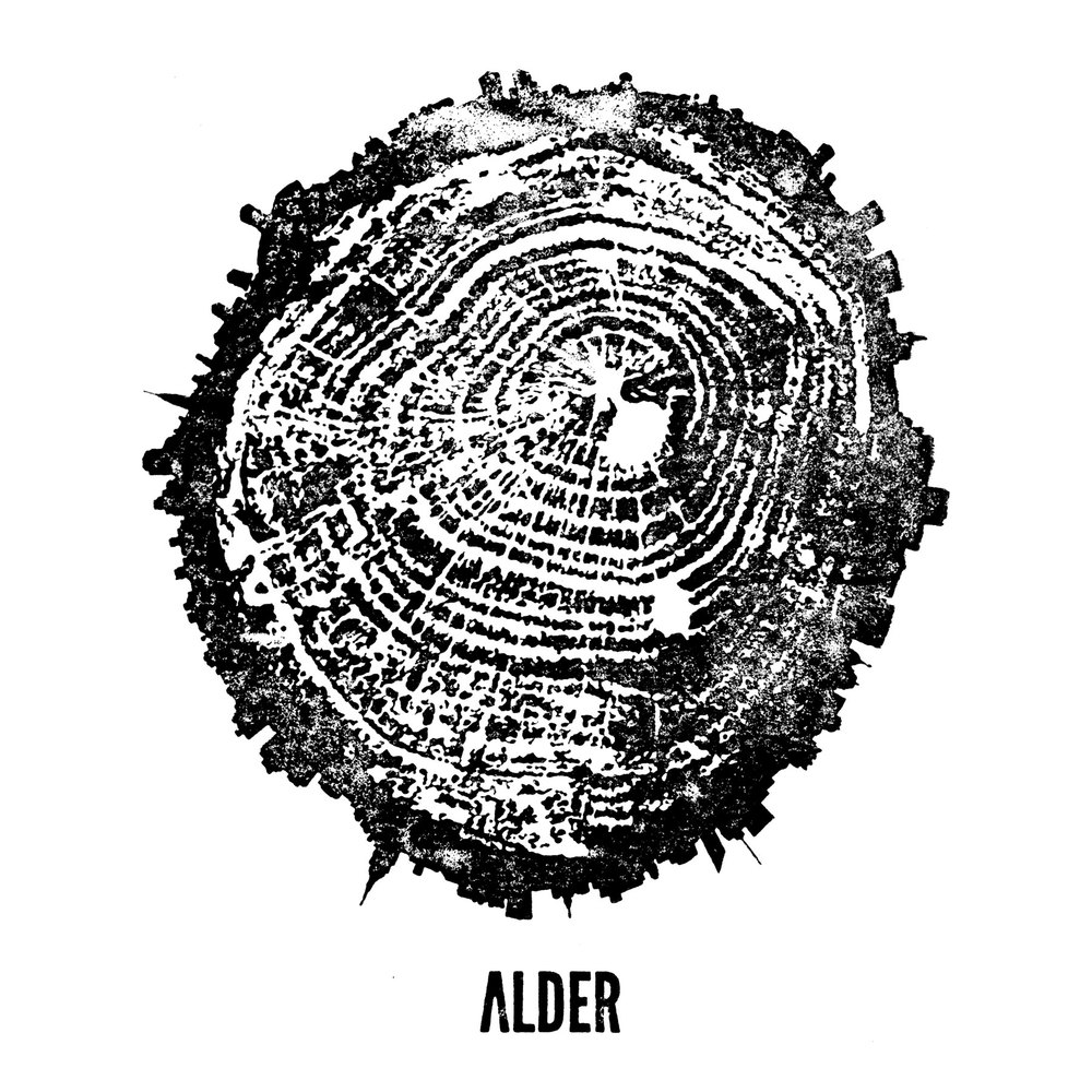 Alder Logo   Alder is an expression of Wylie Dufresne's New England background and the terroir of New York City. The interior, designed by Jennifer Carpenter Architects, blends reclaimed wood from co-owner Stephen Daniel's New England farm, with a beautiful brass bar, rubber tabletops, and the dynamism and innovation of executive chef Jon Bignelli's dishes, and bar director Kevin Denton's beverages.  The logo is inspired by the wood prints of Bryan Nash Gill. We made a print out of wood from the project, and introduced ambiguity by creating a new york city skyline in the bark.      Alder Menus and Table Items   The food menus are presented on reclaimed wood boards (the same boards that line the ceiling of the space) and secured with rubber bands. We continued the rubber theme onto the water bottles, with color coded rubber bands that identify the fresh table water as Still, Fizzy or New York City and are easily swapped as the bottles get reused.