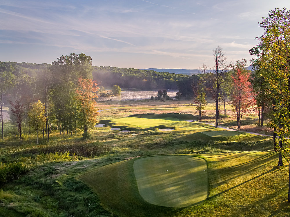 Shepard's Rock is a new 18 hole golf course opened last year at Nemacolin Woodlands Resort. Located atop the Allegheny Mountains, this is the par 3, 165 yard 12th golf hole. Tim Liddy was co-designer with Pete Dye. Photo by Evan Schiller / www.golfshots.com
