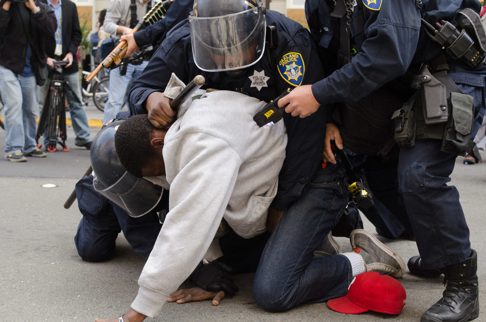 Officers Use a Taser on a Protester During an Arrest