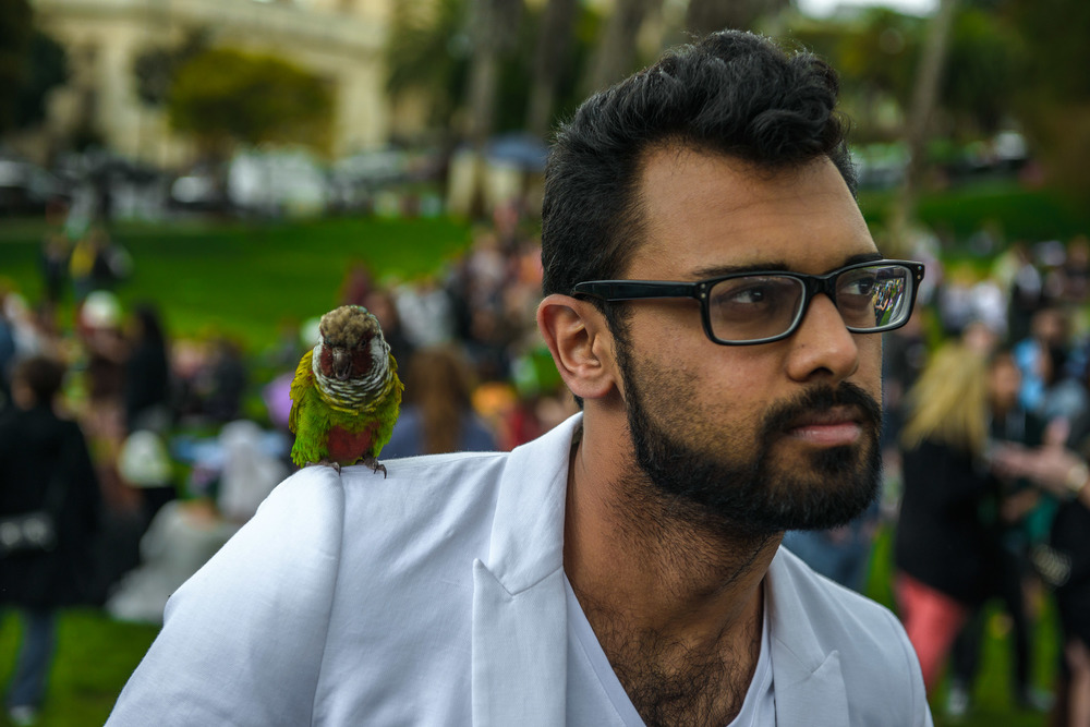 Man with Tiny Parrot
