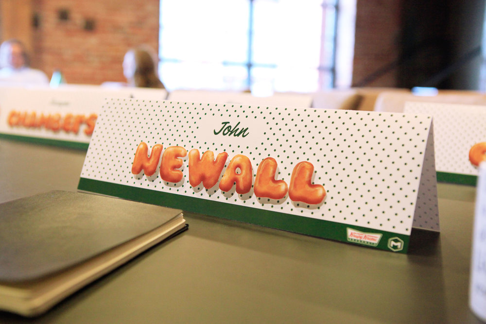 Name cards for the Krispy Kreme pitch, made to resemble a box of doughnuts.