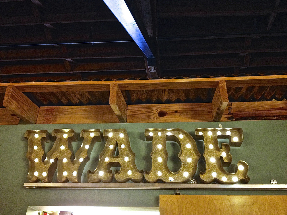 A Boss's Day surprise. Foamcore letters wrapped in paper, 5 cans of glittery spray paint and a few strings of diamond shaped lights makes for some stunning indoor signage.