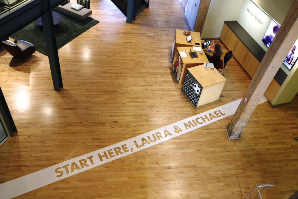 Floor cling with cut out type resembling a starting line for our potential clients.