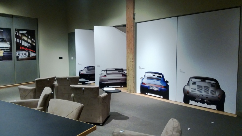 Door coverings with iconic Porche cars on front and back.