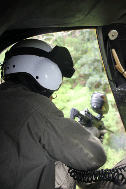"""Figure 7. HBT applicator Brooke Mahnken applies herbicide to miconia. HBT allows for fast, long-range, accurate treatment of miconia from a helicopter.  Photo by C. Duncan.                  Normal.dotm     0     0     1     22     126     Melissa Brown Consulting & Design     1     1     154     12.0                          0     false             18 pt     18 pt     0     0         false     false     false                                                          /* Style Definitions */ table.MsoNormalTable {mso-style-name:""""Table Normal""""; mso-tstyle-rowband-size:0; mso-tstyle-colband-size:0; mso-style-noshow:yes; mso-style-parent:""""""""; mso-padding-alt:0in 5.4pt 0in 5.4pt; mso-para-margin-top:0in; mso-para-margin-right:0in; mso-para-margin-bottom:10.0pt; mso-para-margin-left:0in; line-height:115%; mso-pagination:widow-orphan; font-size:11.0pt; font-family:""""Times New Roman""""; mso-ascii-font-family:Calibri; mso-ascii-theme-font:minor-latin; mso-hansi-font-family:Calibri; mso-hansi-theme-font:minor-latin;}"""