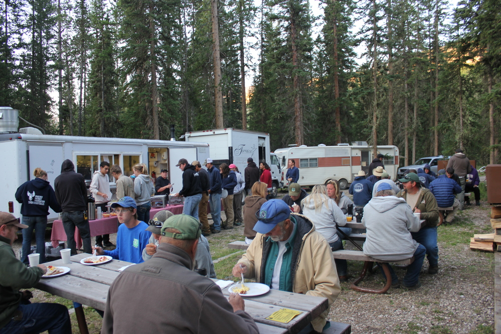 VOLUNTEER CREWS gather for breakfast before heading out to the field. Photo by Celestine Duncan.