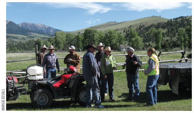 RANCHERS MEET    in the grazing allotment to discuss weed infestations that need to be treated.