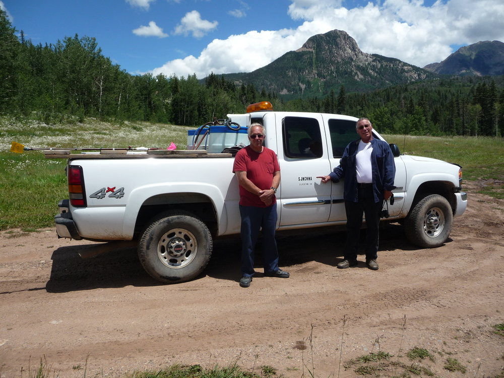 Alex Rea (US Coast Guard Veteran-left) and Glen Sheridan (US Airforce Veteran-right) standing in front of the truck used by the San Juan Mountain CWMA. Photo by Rod Cook