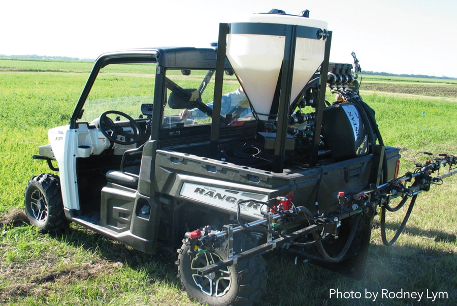 Figure 2:   Herbicides were applied with a Ranger ATV-mounted boom sprayer, equipped with pulse modulating nozzles. A tractor-mounted boom sprayer with 8002 nozzles was used as the control treatment for comparison. Photo by ROdney Lym.