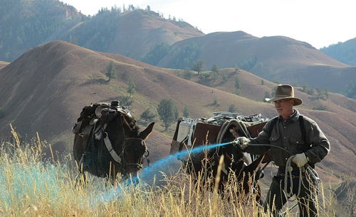 Figure 3:  Dave Hanna treating cheatgrass on steep hillsides in the backcountry.