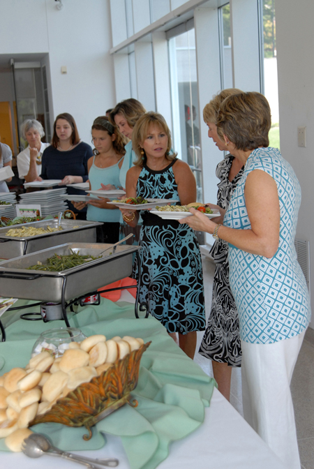 "Attendees enjoying the ""spread."""