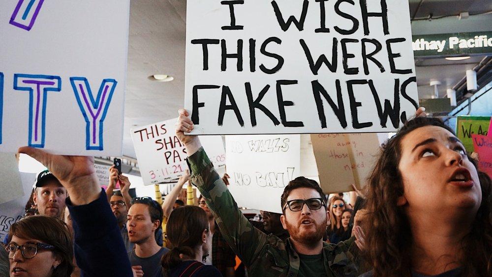website photo protest wish this were fake news.jpg