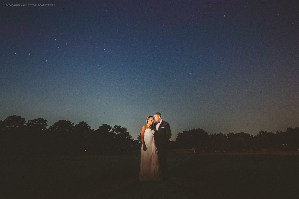 night time portrait with bride and groom