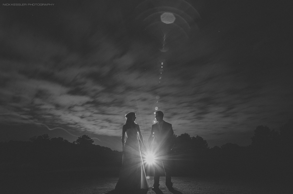 creative night portrait of bride and groom with long exposure