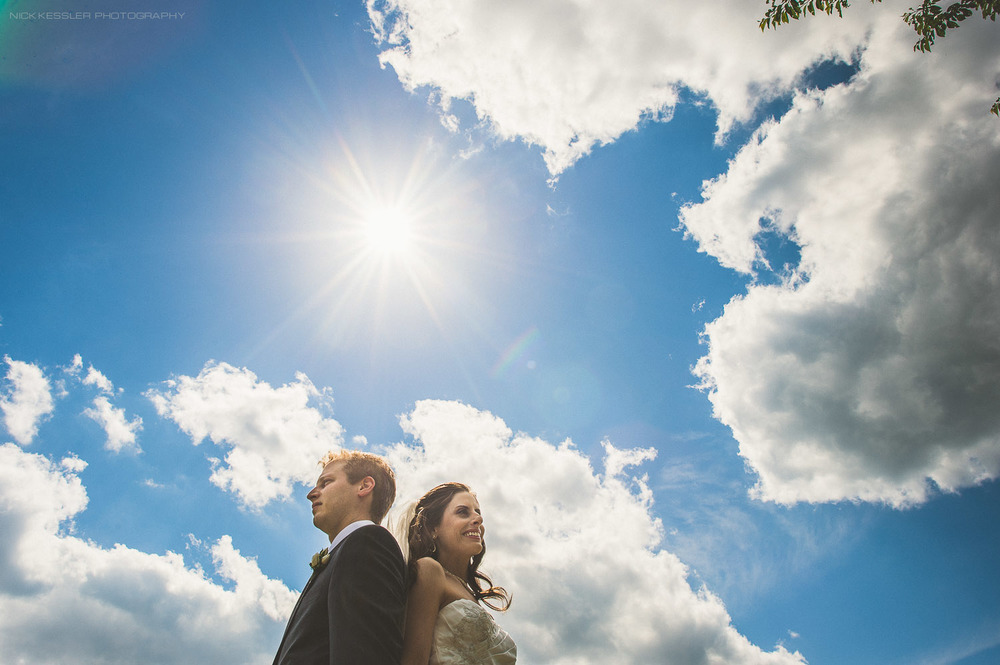 bride and groom at wedding with blue sky