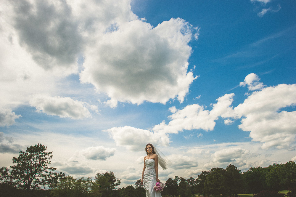 portrait of bride with clouds