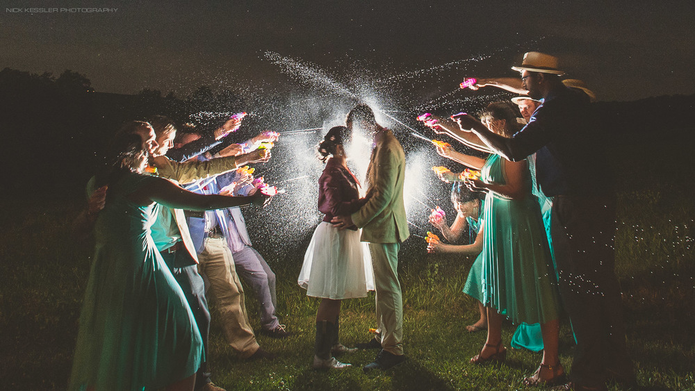 creative portrait with wedding party at night