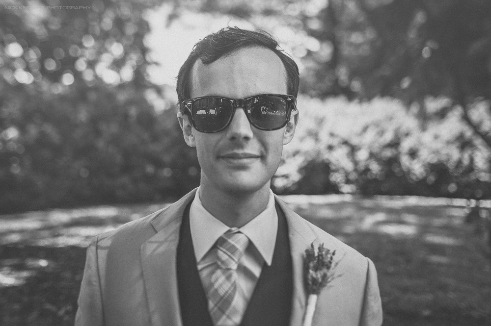 black and white portrait of groom on wedding day