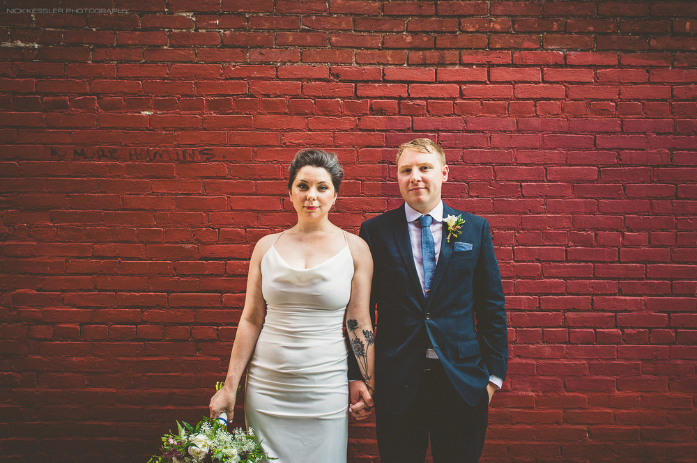 portrait of bride and groom in alley
