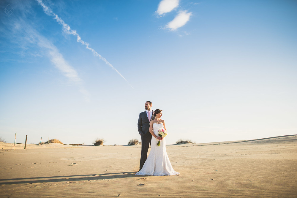 bride and groom portrait on beach