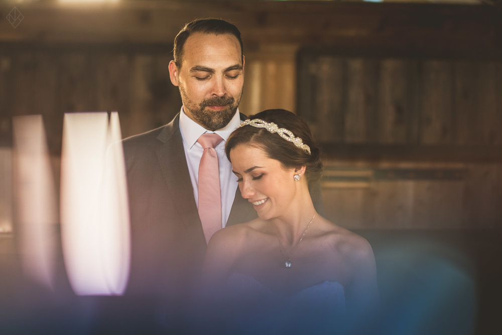 creative portrait of bride and groom using a prism