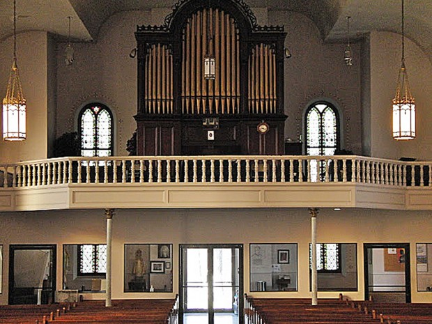 The pipe organ in its former home, St. Mary's in Muscatine, Iowa.