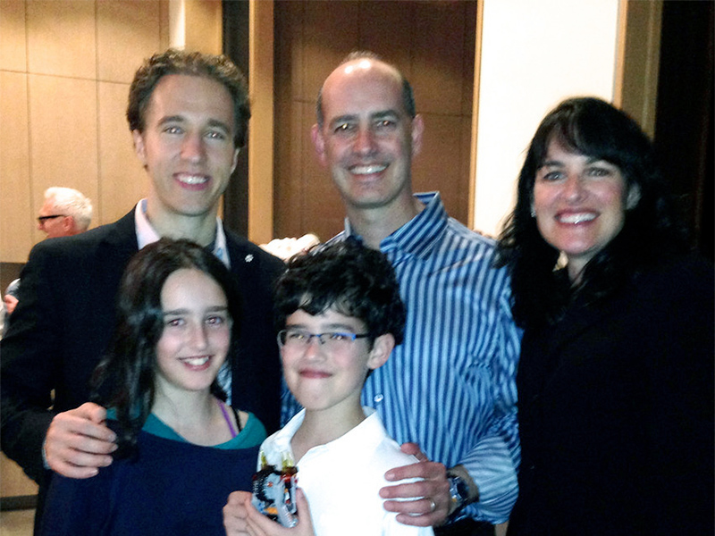 Craig Kielburger with Jason and Ann Green and their two children.