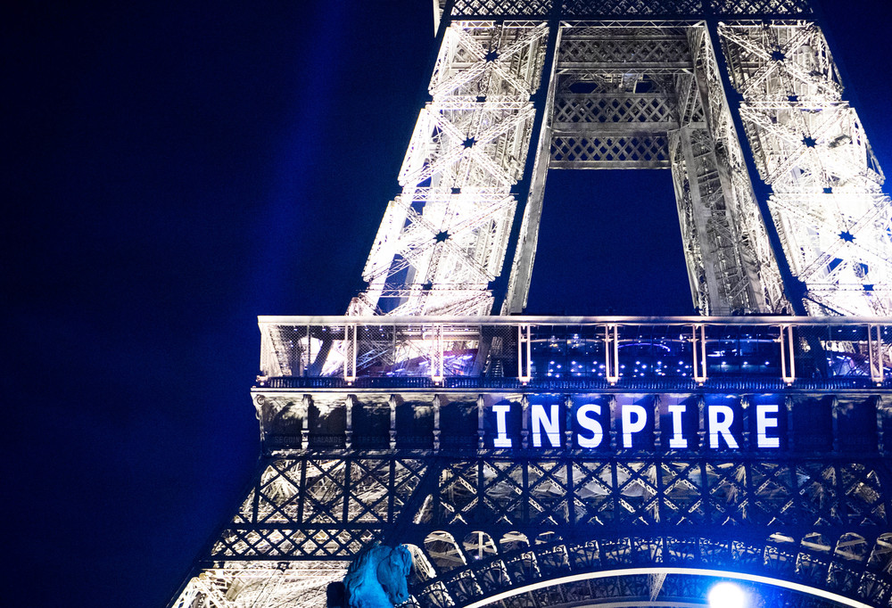 """Inspire"" projected onto the Eiffel Tower by  #Climatesign"
