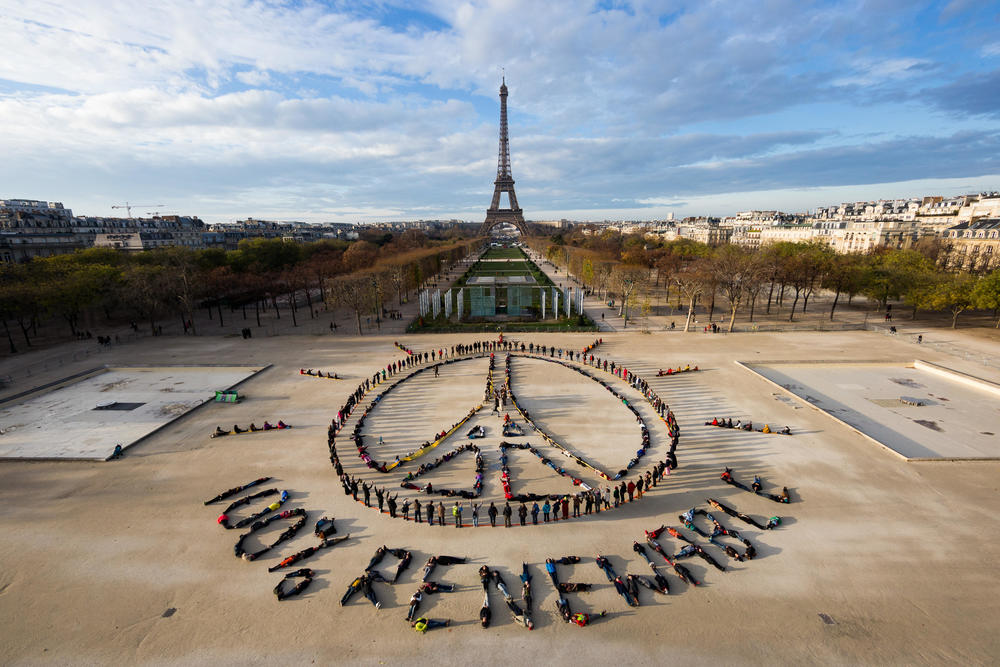 Hundreds from around the world unite in a giant message of freedom, standing with the people of Paris and calling for 100% renewable energy, during the United Nations COP21 Climate Summit. Photo by Yann Arthus-Bertrand / Spectral Q