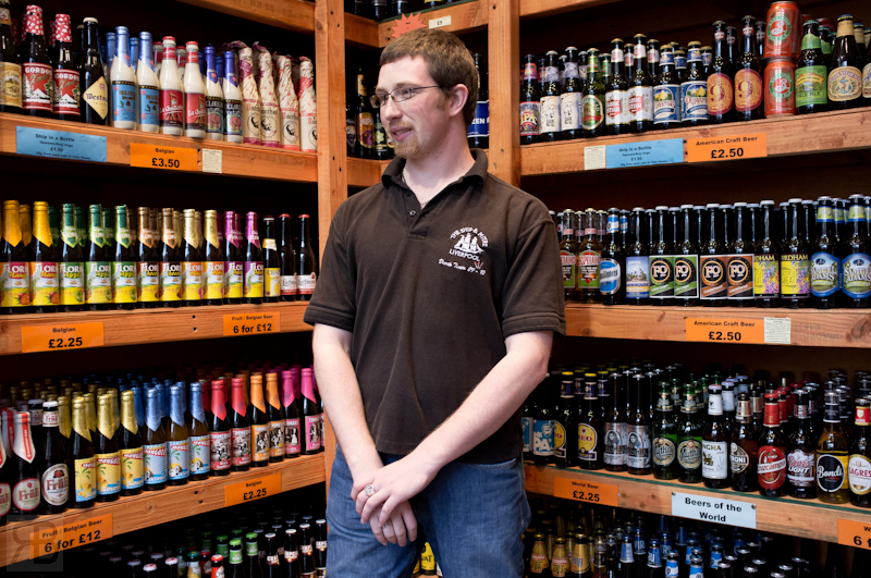 This is Ian from Ship in a Bottle (http://www.theshipinabottle.co.uk/ ). It's a great shop that sells all kinds of world beers/ales.  I bought me and Mark some to try one of which was a local brew I had not tried, they went down nicely.  Whilst talking to Ian I made a portrait of him, this is just available light with the Fuji X100.