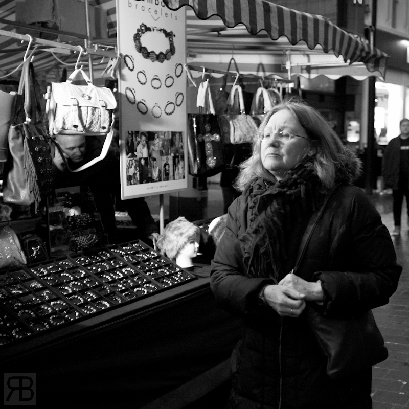 I used a small LED light that was attached to the market stall for this shot, noticed people passing through the light and figured it would be better than no light at all.. its was getting dark!
