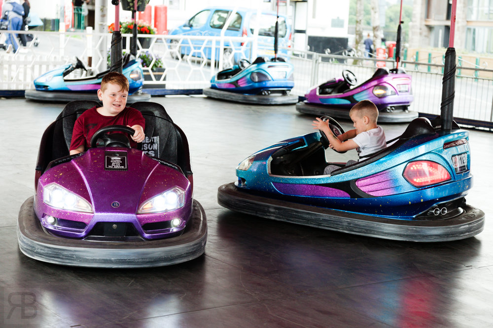My god sons on the bumper cars.  5D Mark II + 24-105 F4 L lens.   ISO  1250  F5  1/250th sec.  Available light.