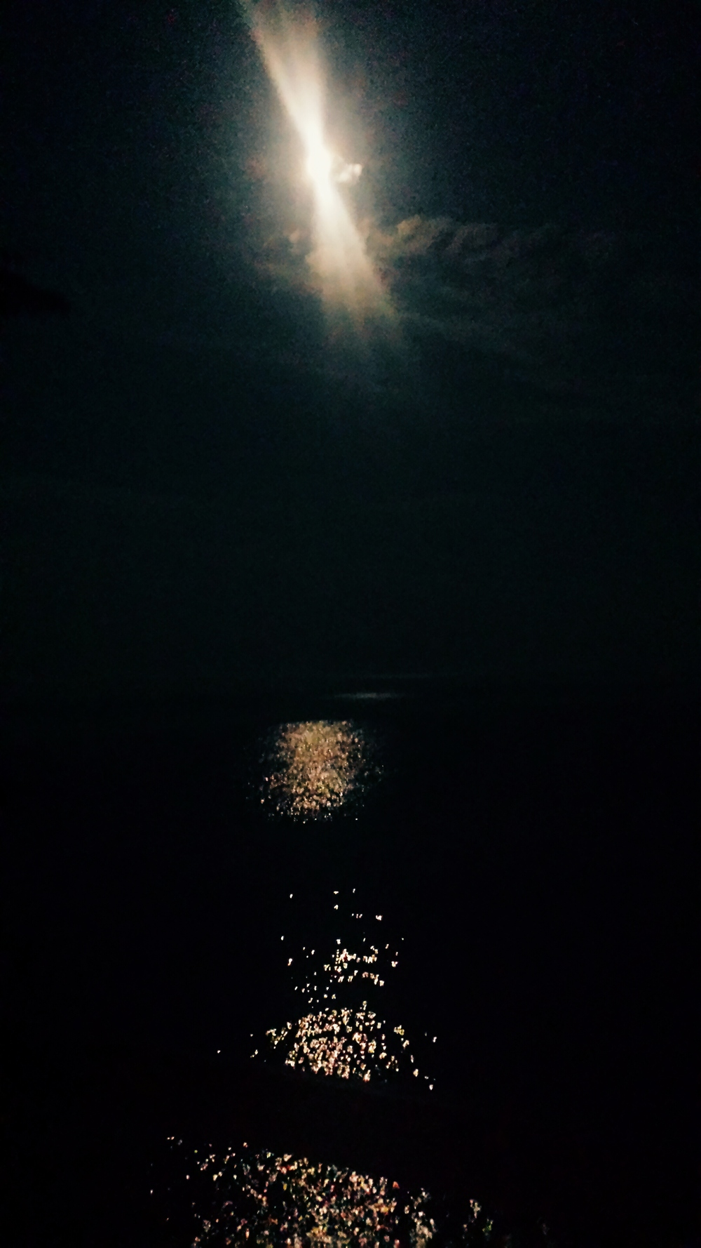 "The super moon over the water in Lutsen, Minnesota. Also, you'll notice the clouds spell out ""Luce"" which means ""Light."" MAGIC."
