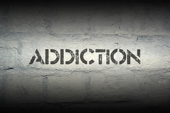 "[feature image shows black and grey background with bold text that reads: ""Addiction"" via]"