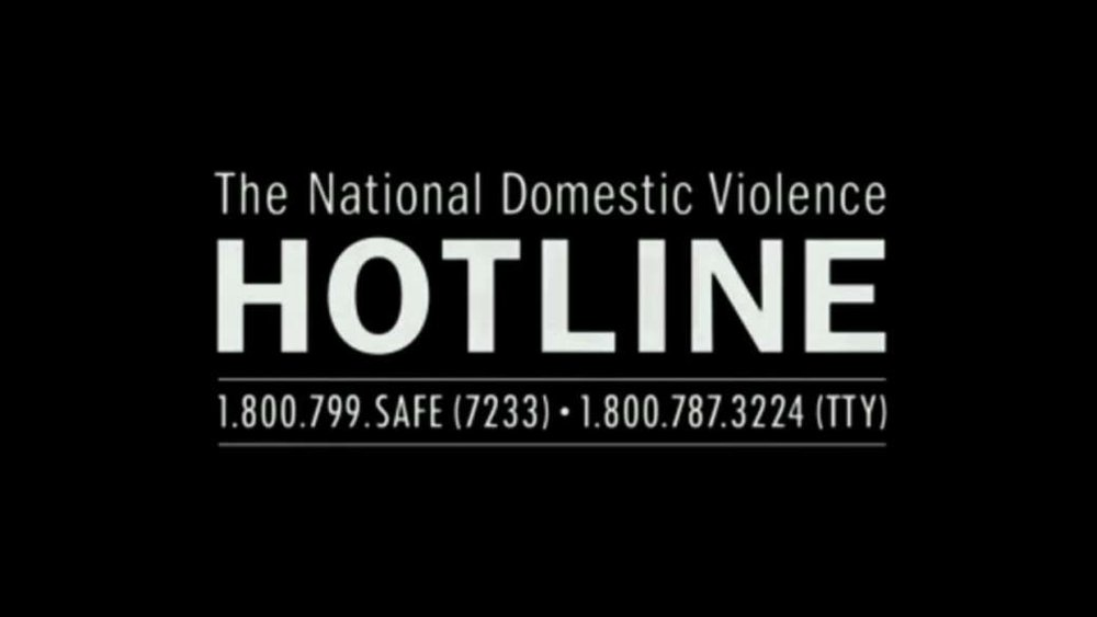 "[feature image shows black backgrounds with white text that says: ""The National Domestic Violence Hotline: 1.800.799.SAFE (7233); 1.800.787.3224 (TTY)"" via]"