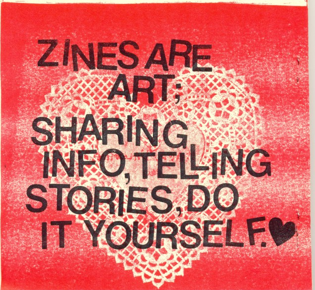 "[feature image shows red background with white, doily-shaped heart. Text overlapping says: ""Zines are art; sharing info, telling stories, do it yourself.""  via ]"
