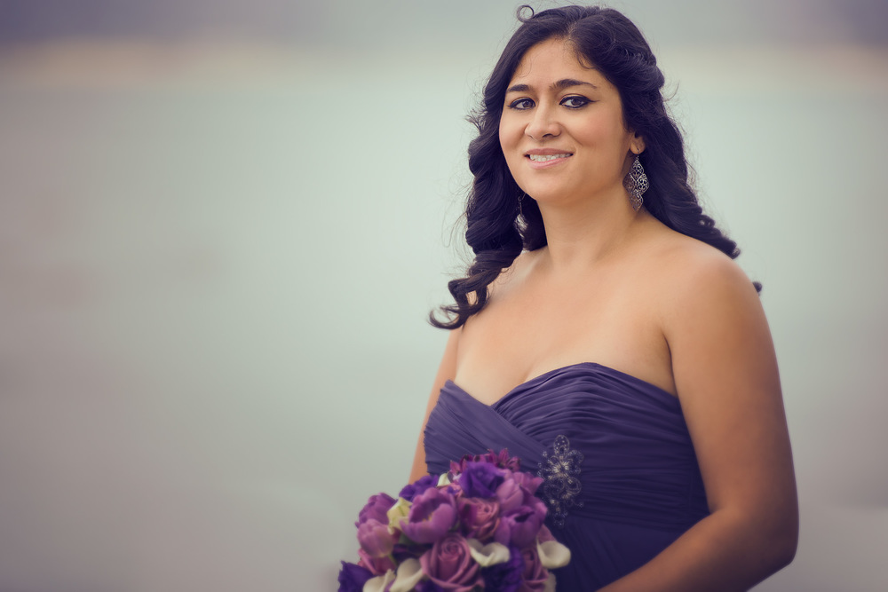 My beautiful wife was a bridesmaid. In between the formals I grabbed this shot of her.