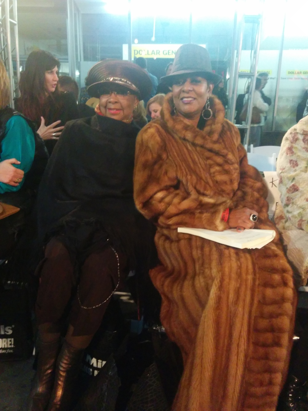 Fashionable show attendees.  Those furs were more than necessary that night because it was very cold that night.