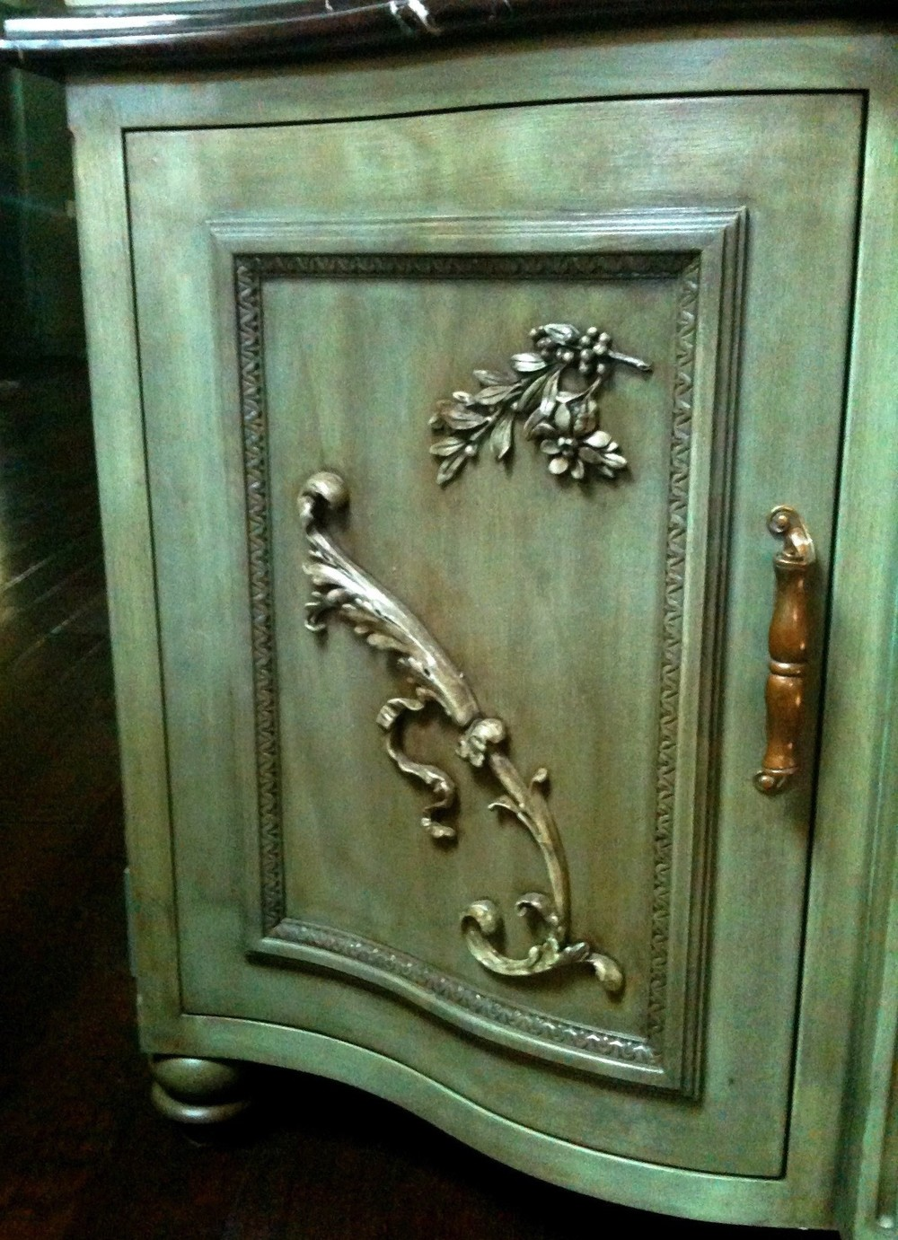 Kitchen hutch door with embellishments.
