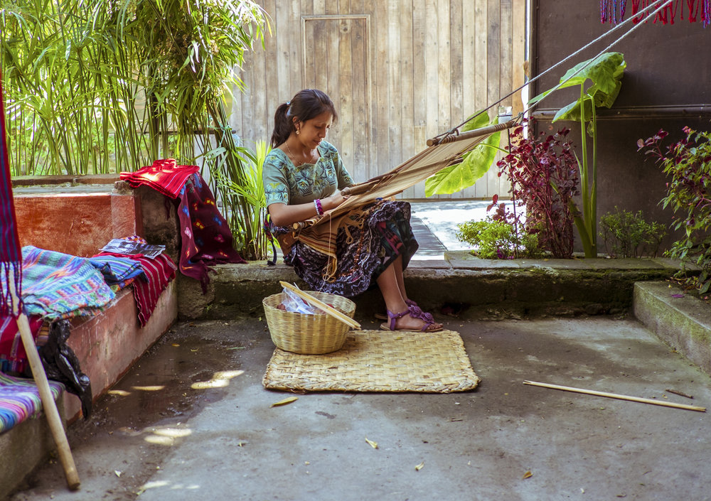 The Weaver, 2012. Guatemala is known for its handicrafts, especially in the art of weaving. As with the original Mayans, many women in Guatemala specialize in weaving traditional attire, scarves, bags, among other things.