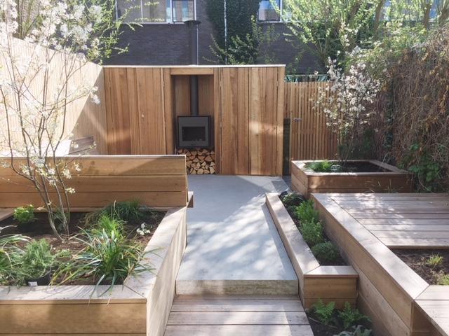 Tuinontwerper Amsterdam loungetuin met haard