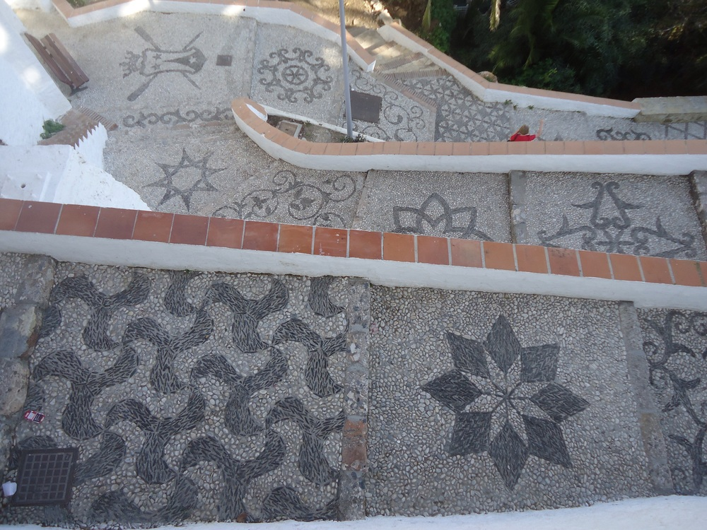 Mosaic steps down to one of the small bays