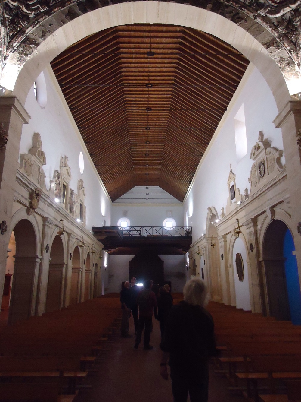 The main body of the church is quite simple with an amazing wooden ceiling and side alters
