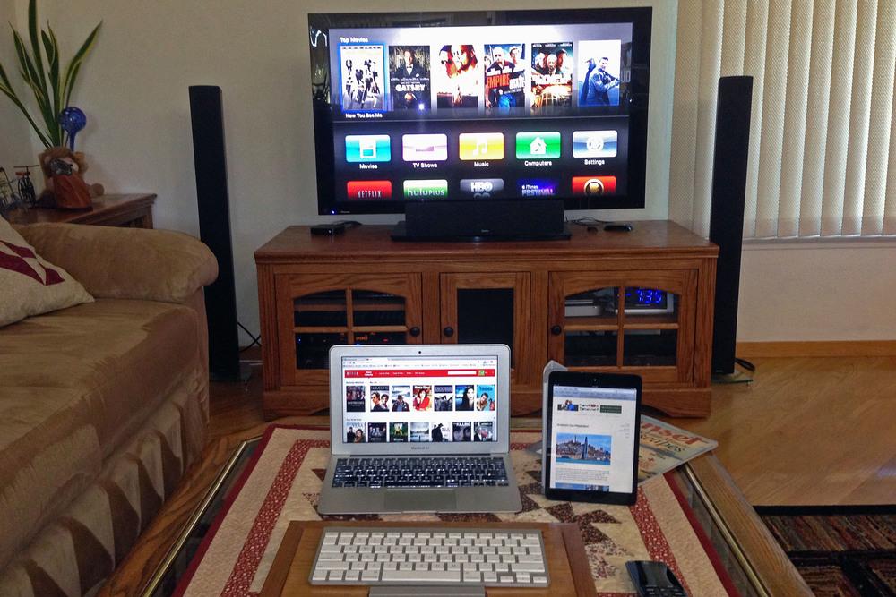 Apple TV, Netflix on laptop, & Internet on tablet