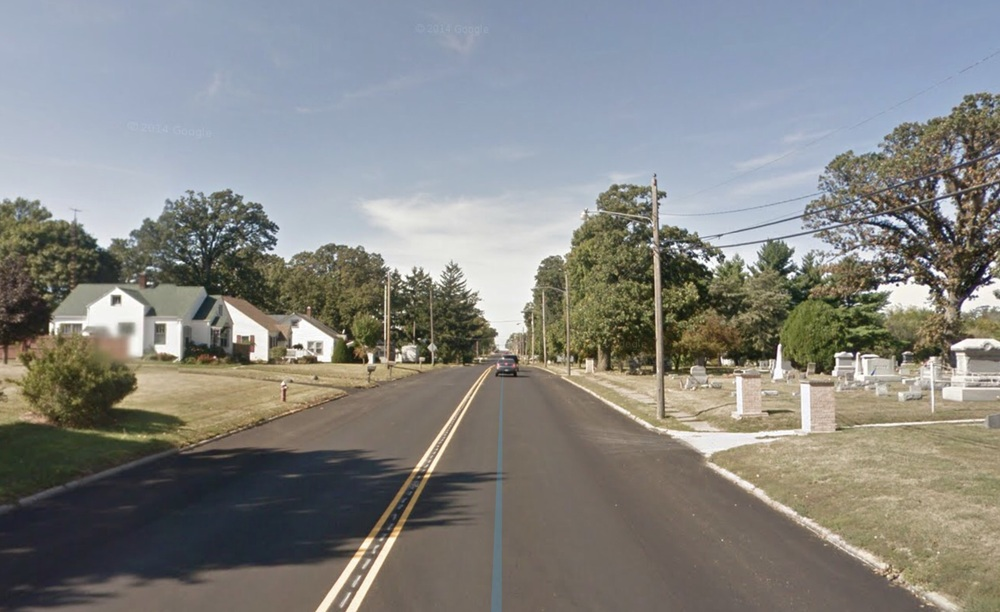 Houses, Gravesites, Trees and Rolling Hills