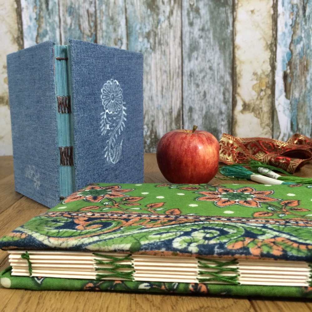 Hand-bound books from aged denim and vintage cotton saris
