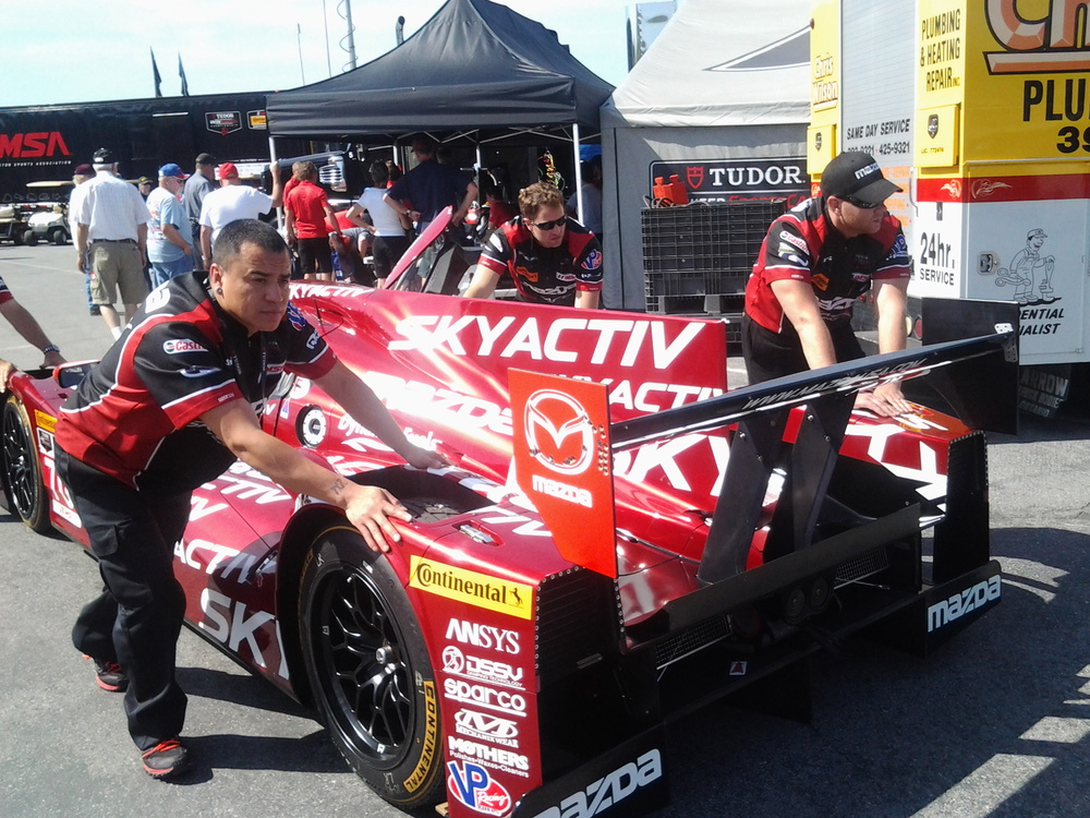 VETMotorsports crew member in the IMSA pits with SpeedSource.
