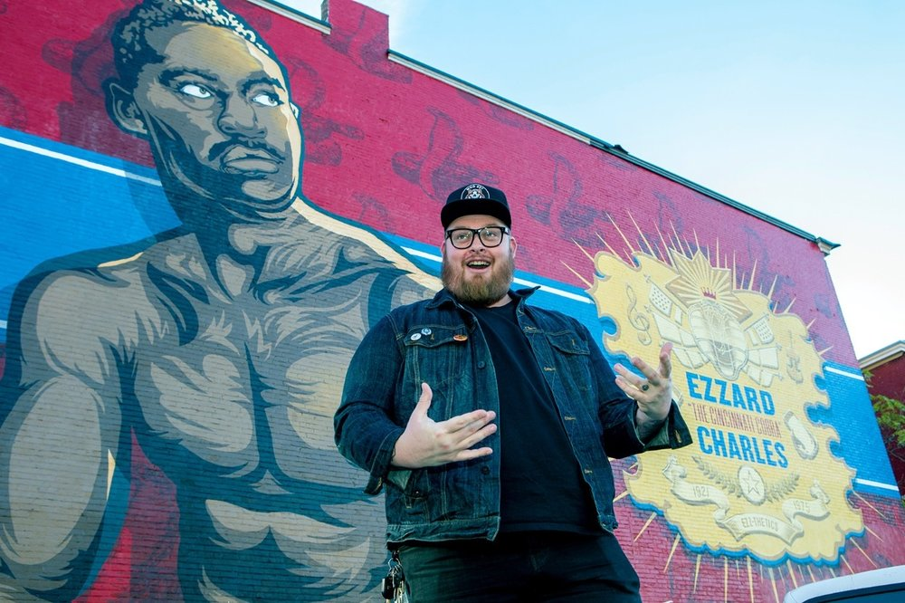 UC.edu, Jason Snell of WHBV with the Ezz mural, photo by Andrew Higley