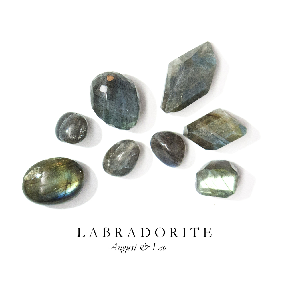 "L A B R A D O R I T E - Belonging to the Feldspar family of stones (which make up about sixty percent of the earth's crust) Labradorite is an incredible stone with florescent luminescence. At first look, Labradorite is a deep grey but once light hits certain veins in the stone it shines bright blue.  According to Inuit legend, a warrior created the Aurora Borealis by striking a Labradorite stone and releasing its luminescence.   Known as the ""Stone of Magic"" to diviners and healers, Labradorite is the stone of mystical self-discovery.  Labradorite is generally found in Norway and Canada."